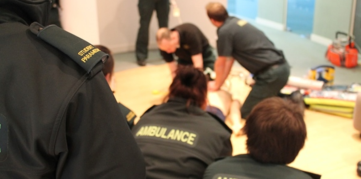 Student paramedics watching intermediate life support demonstration