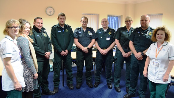 Ambulance staff and occupational therapists group team photo
