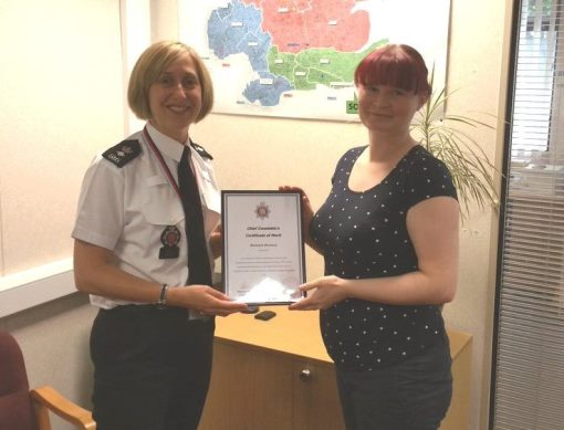Barbara receives her award from Essex Police