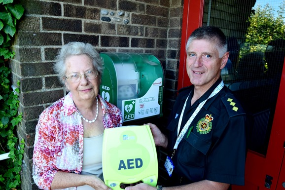 Margaret Carter and Andrew Barlow with the new defibrillator in Hempton