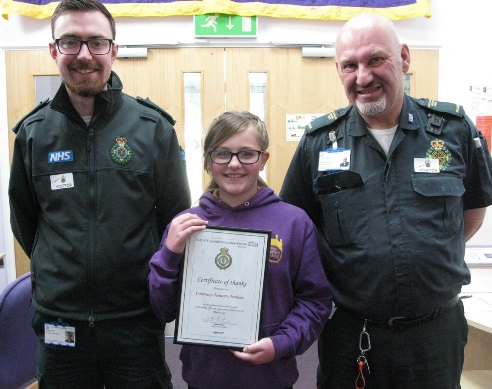 Courtney-Jeanette Jeakins with call handler Robert Pitt and paramedic Simon Wicker