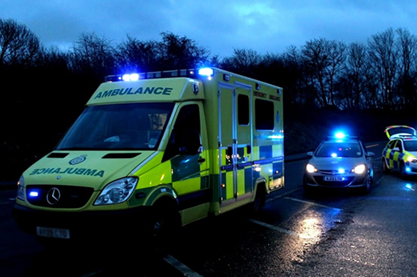 Ambulance and officer vehicles at RTC