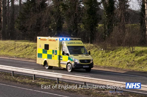 Ambulance driving on blue lights along the A11