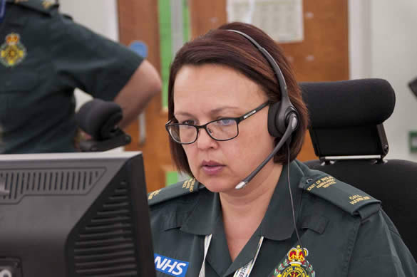 999 Call Handler on headset in front of computer screen