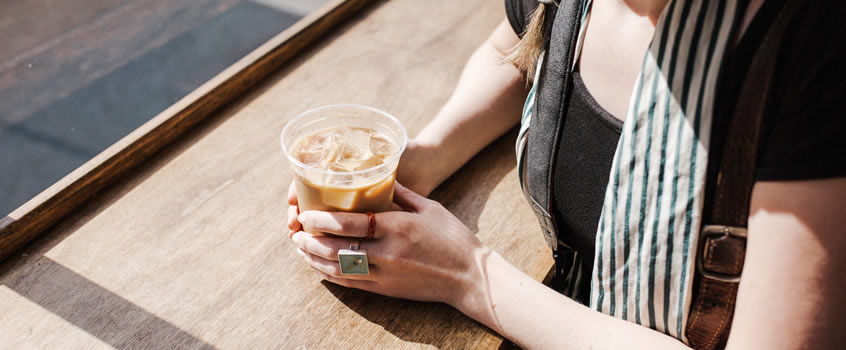 pexels person holding iced coffee 3341605 homepage